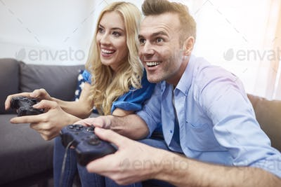Couple having fun while playing video game
