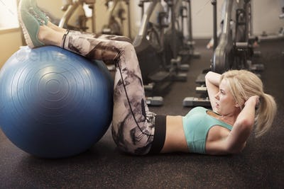 Doing sit ups on fitness ball