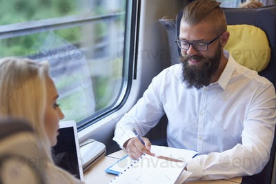 Business meeting during the traveling by train