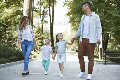 Walking family at the park