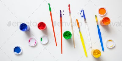 Colorful finger paints set on white color background, top view