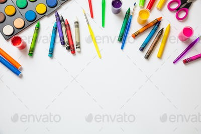 Colorful paints on white color background, top view