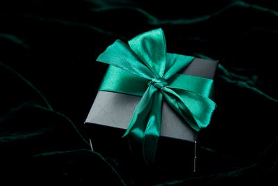 One luxury black gift boxe with green ribbon