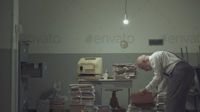 Businessman working in a messy office