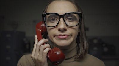 Woman having a boring phone call