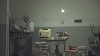 Businessman searching for files in a messy office