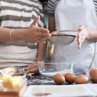 Female Cooks Sieving Flour