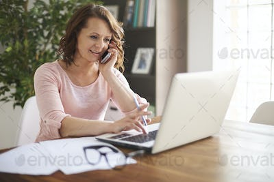 Busy businesswoman working at home office