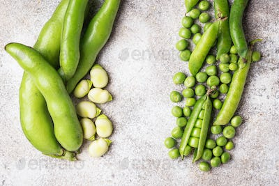 Fresh green peas and beans on light background
