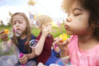 Blowing the bubbles with my friends