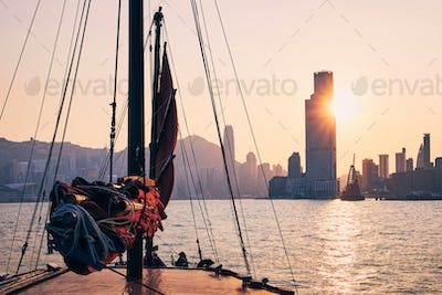 Traditional Junk boat against Hong Kong cityscape