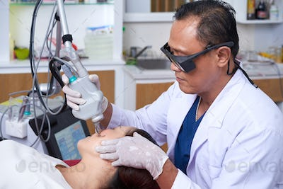 Plastic surgeon working at clinic