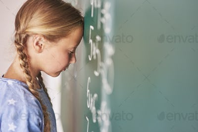 Schoolgirl trying to understand formula