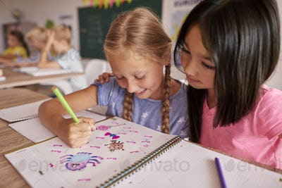 Two girls looking at the picture
