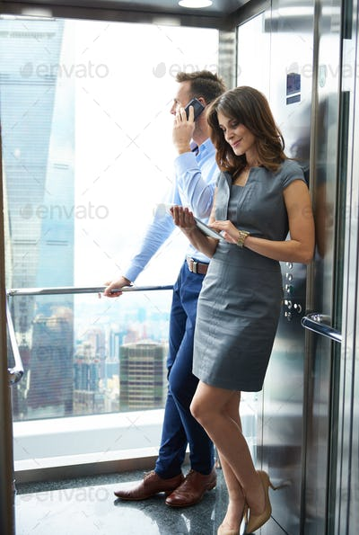 Business partners in the lift