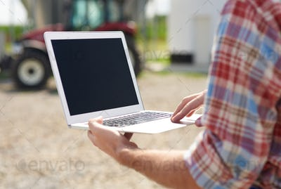 Close up of laptop used on the farm