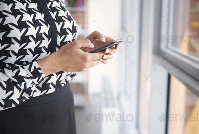 Woman using her black mobile phone