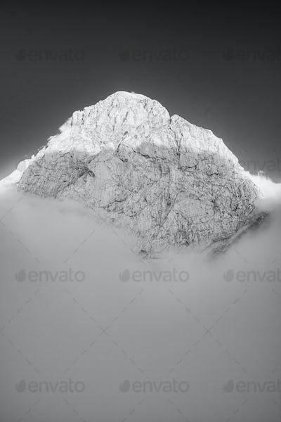 Mountain Peak Above Clouds. Black and White Monochrome Fine Art