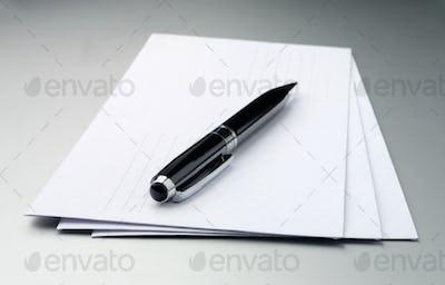 envelopes and a pen