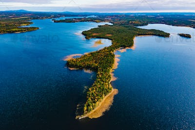 Aerial view of fall landscape with blue lakes and  beautiful autumn forests in Finland