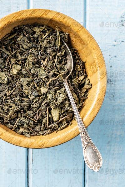 Dried green tea leaves.