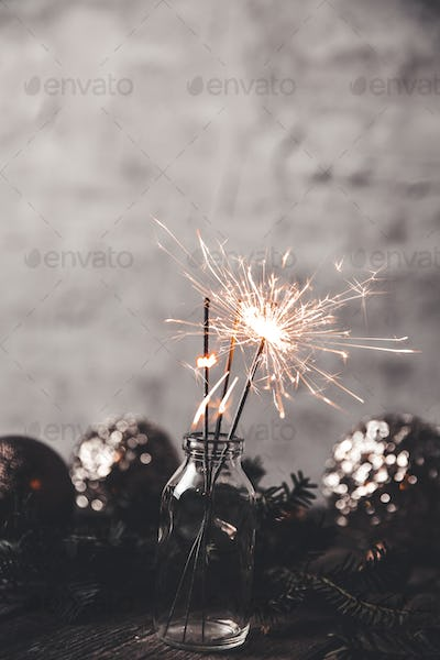New Year's, Christmas background with Christmas sparklers and Christmas-tree toys. Holidays