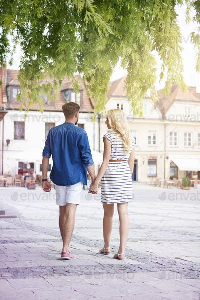 Couple walking at the old town in summer day
