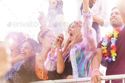 Audience With Colored Smoke Behind Barrier Dancing And Singing At Outdoor Festival Enjoying Music