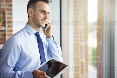 Businessman with digital tablet and mobile phone