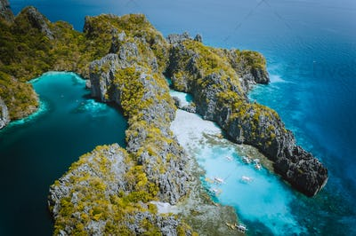 Palawan, Philippines aerial drone natural scenery of turquoise lagoon and limestone cliffs. El Nido