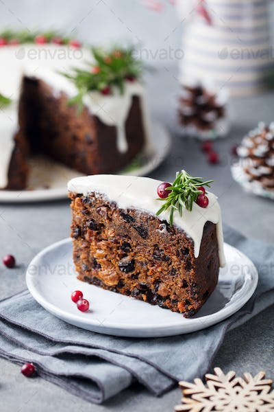 Christmas Fruit Cake, Pudding on White Plate. Close up.