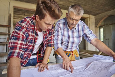 Two of carpenters are planning another steps