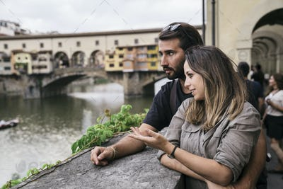 Couple in love visiting Florence Italy and enjoying most famous landmarks