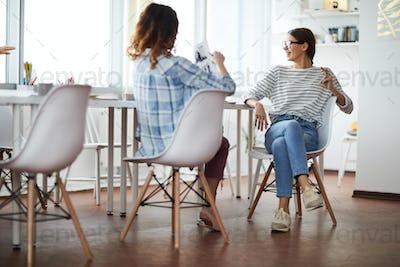 Contemporary Young Women Enjoying Meeting