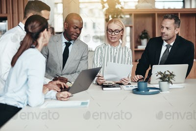 Diverse group of businesspeople working together at an office table