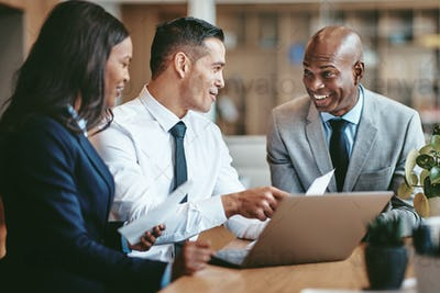 Smiling diverse businesspeople working together in a modern office
