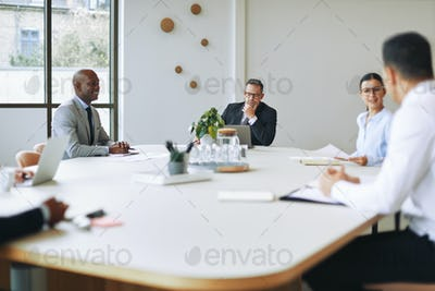 Diverse businesspeople having a meeting around a boardroom table
