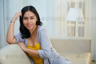 Beautiful Filipino woman on sofa