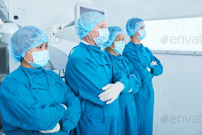 Confident surgeons looking away