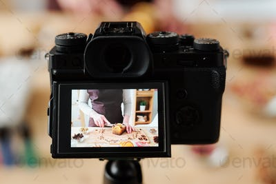 Craftswoman in camera recording video of master class of making handmade soap