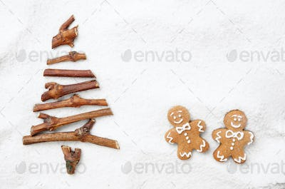 Flat lay stylized Christmas tree made of small twigs and gingerb