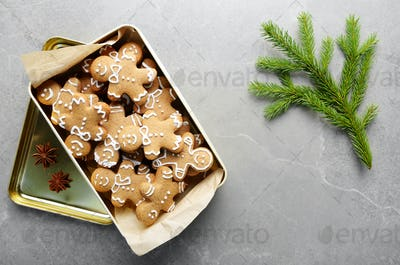 Flat lay Christmas background with cookie box and fir palm on st
