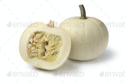 Whole and halved white Lumina pumpkin