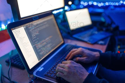 Programmer hands on keyboard, network security