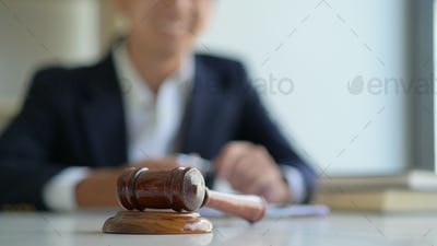 Concept of justice, Hammer and the lawyer are giving legal advice.