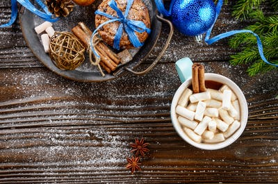 Flat lay Christmas background of blue mug with hot chocolate and