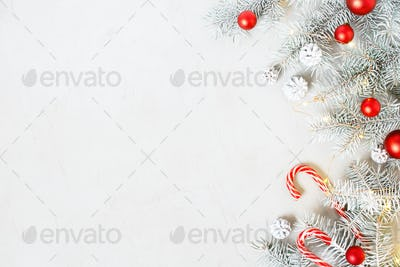 Christmas Background With Frosty Fir Branches and Red Decoration