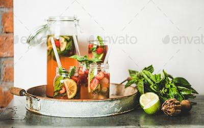 Fresh strawberry and basil lemonade in glass jars, copy space