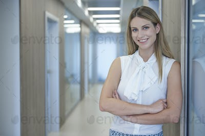 Portrait of young and cheerful businesswoman