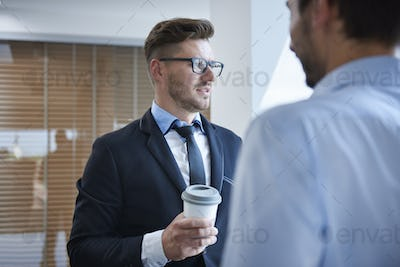 Men talking over a cup of coffee